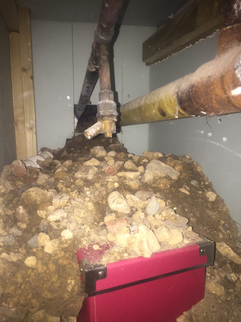 Image of excavations under a house caused by rats